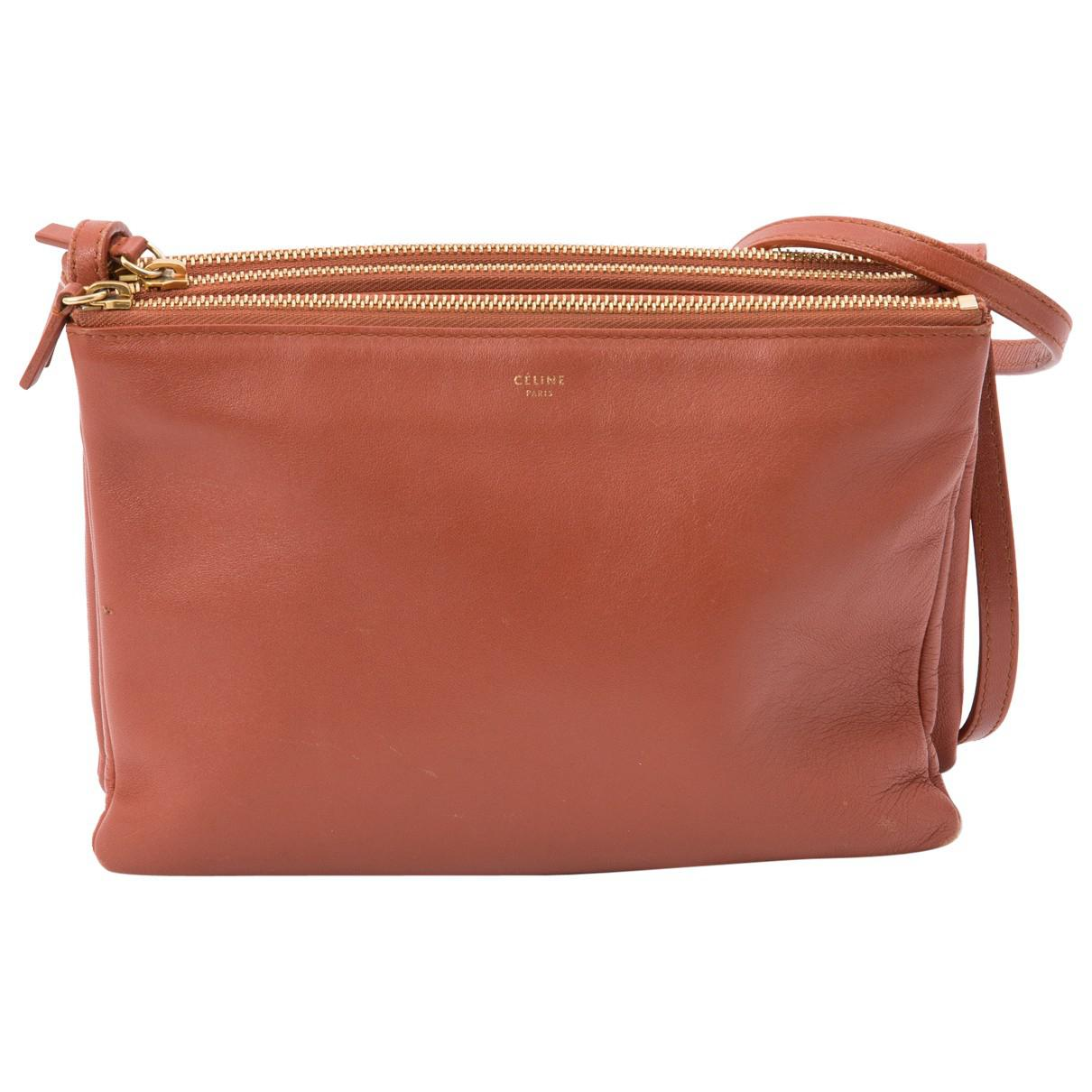 a929367296 Lyst - Céline Pre-owned Trio Leather Clutch Bag in Brown