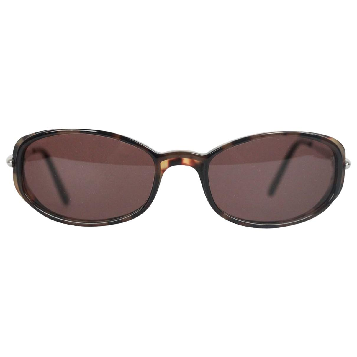 c048501c2a1 Lyst - Cartier Sunglasses in Brown
