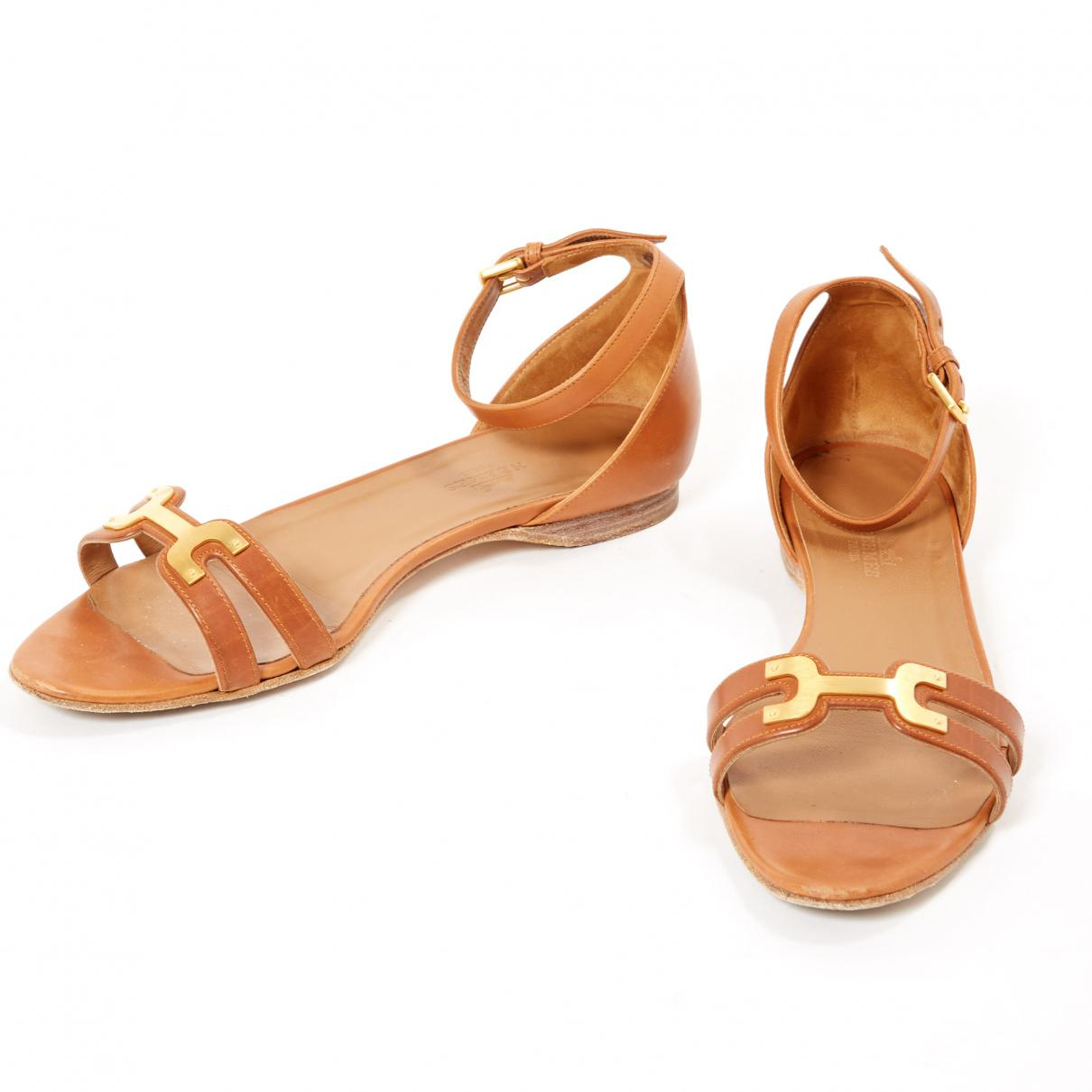 b570e3d56b09 Lyst - Hermès Pre-owned Brown Leather Sandals in Brown