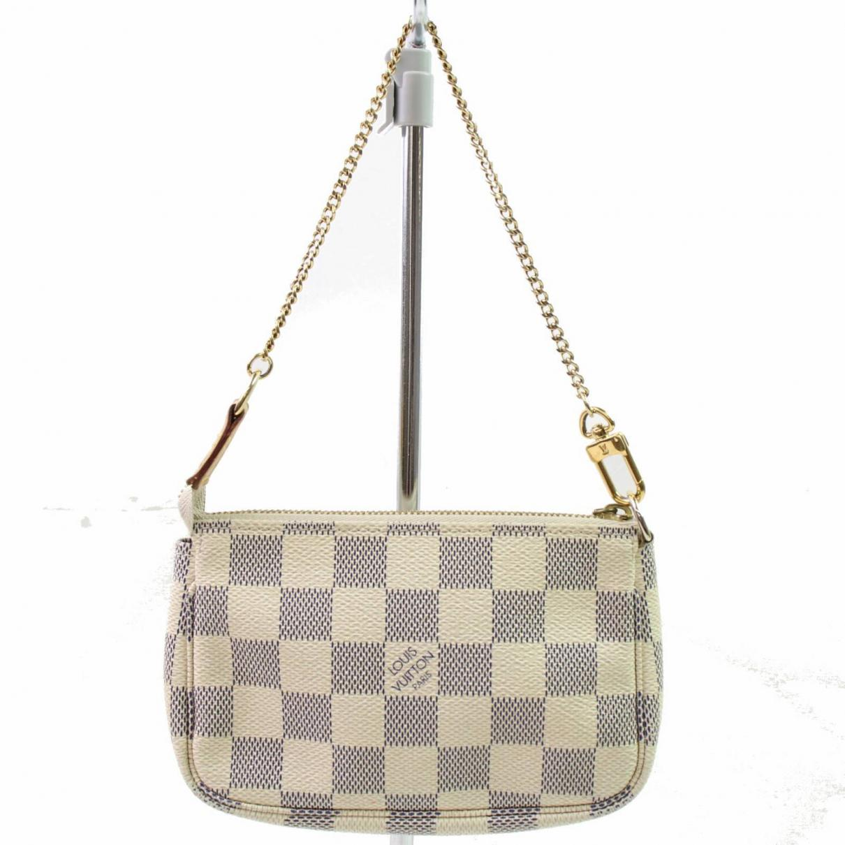 b46fe260ca5a Lyst - Louis Vuitton Pochette Accessoire Leather Clutch Bag in Metallic