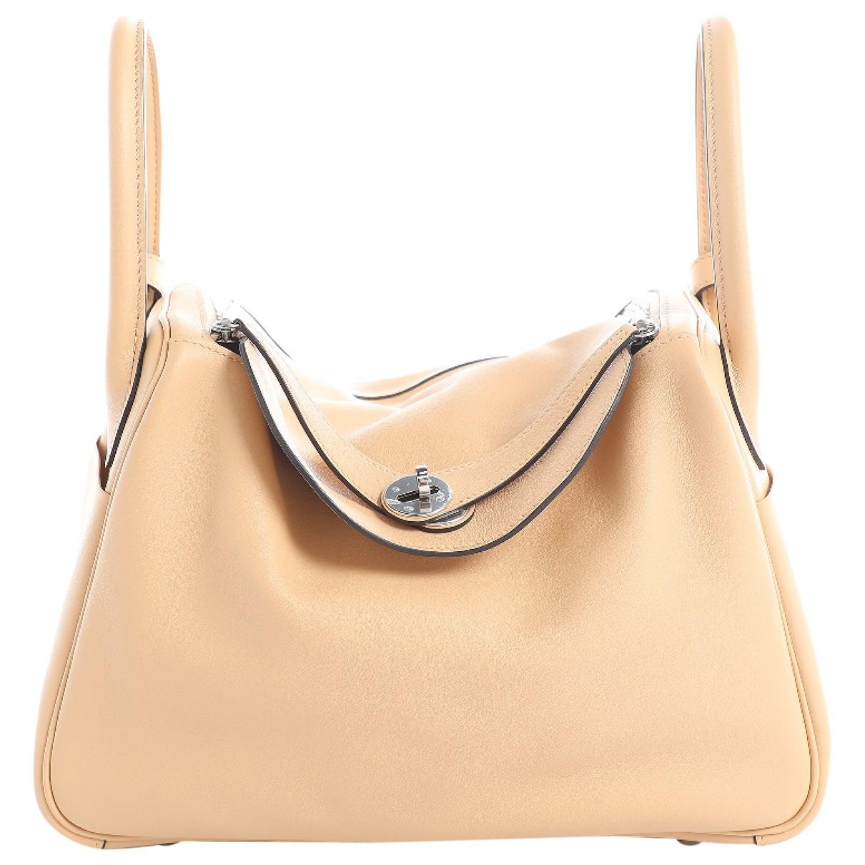 fcae349a4c ... best price hermès pre owned lindy leather bag in natural lyst 24b22  8fb0a ...