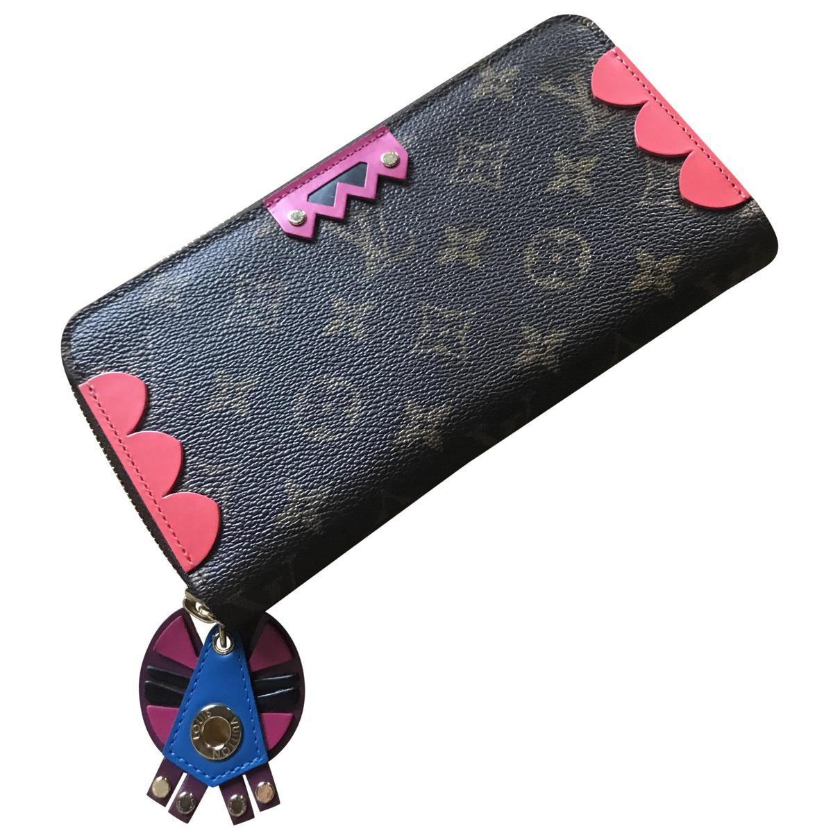 38b72ff15266 Lyst - Portefeuille Zippy en toile Louis Vuitton