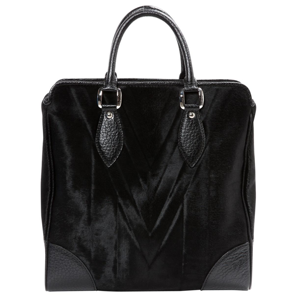 33711b98436c Lyst - Louis Vuitton Pony-style Calfskin Handbag in Black