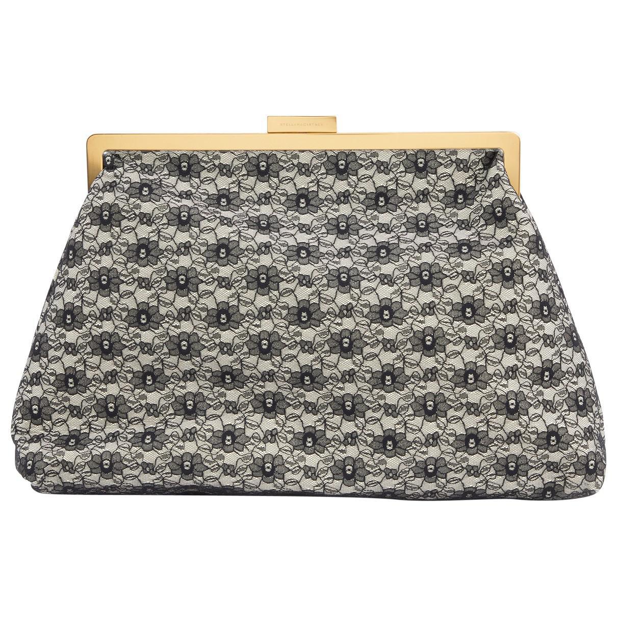d2d05d602e80 Stella McCartney Pre-owned Black Cloth Clutch Bags in Black - Lyst