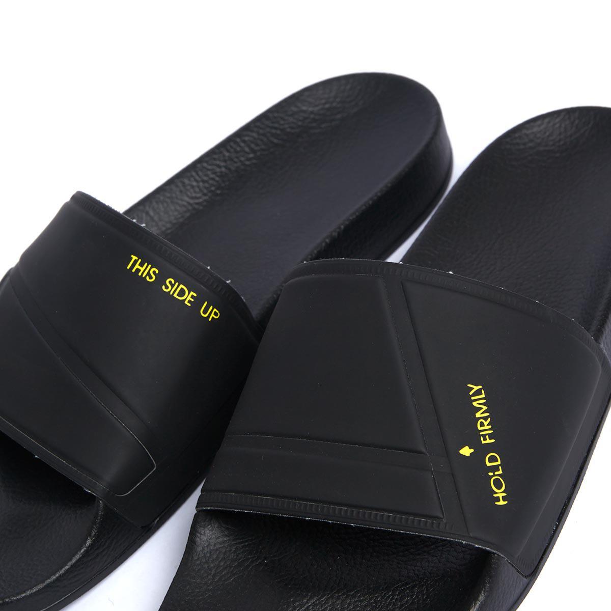 4e08fd77c1f7 Lyst - adidas By Raf Simons Bunny Adilette Rubber Slides in Black ...