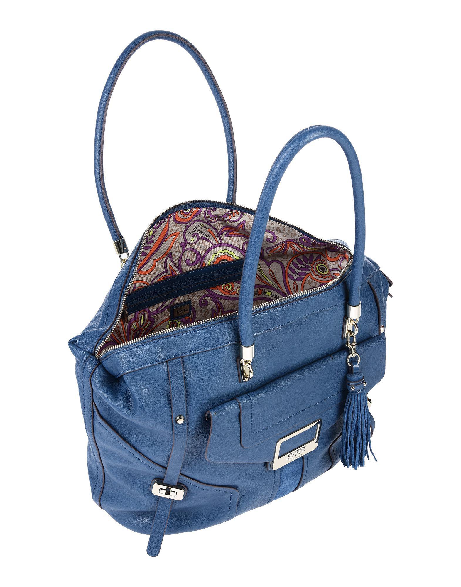 a1715ea62164 Lyst - Guess Handbag in Blue