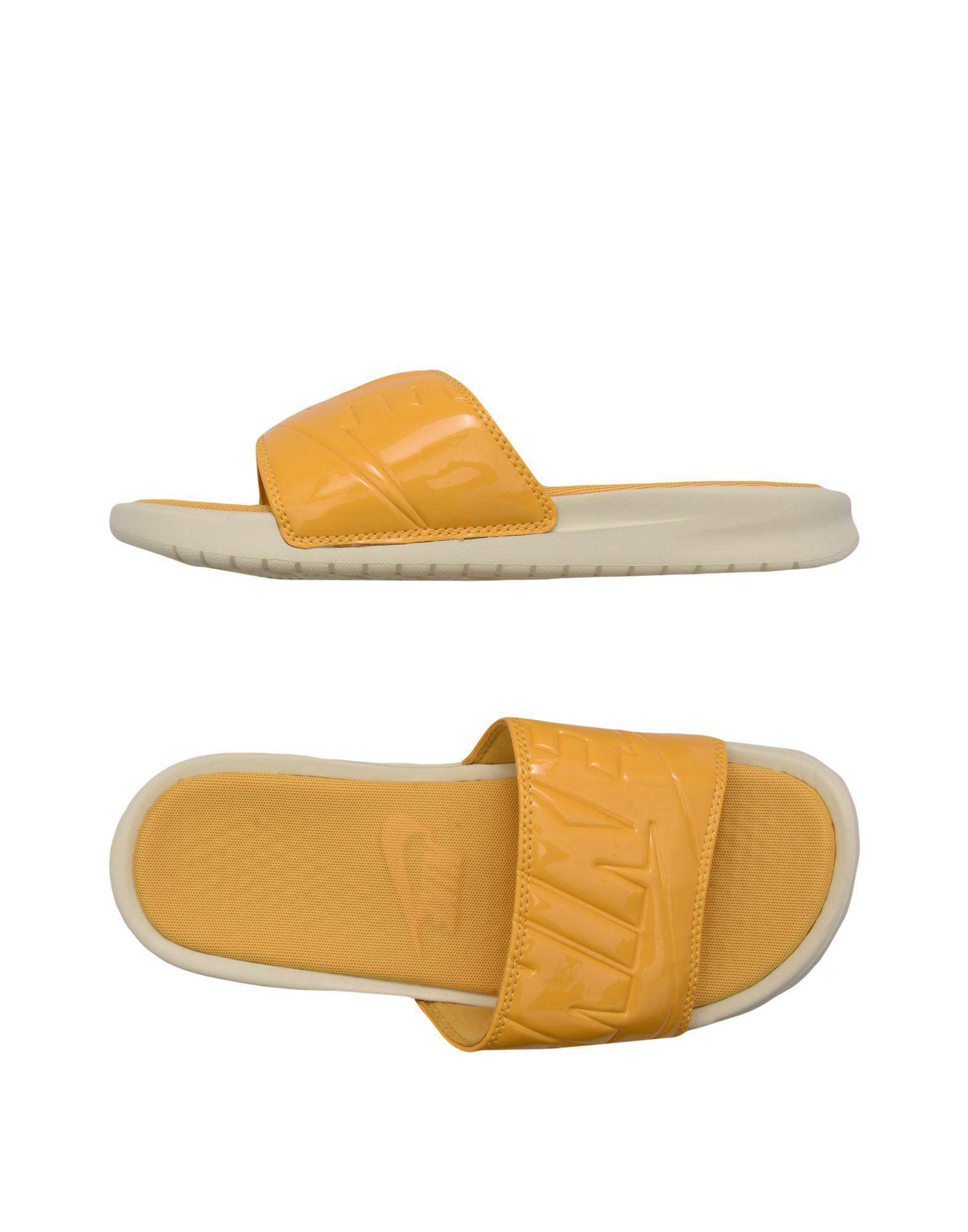 ae92610b6f96 ... best price nike. womens yellow sandals b1603 02b0e