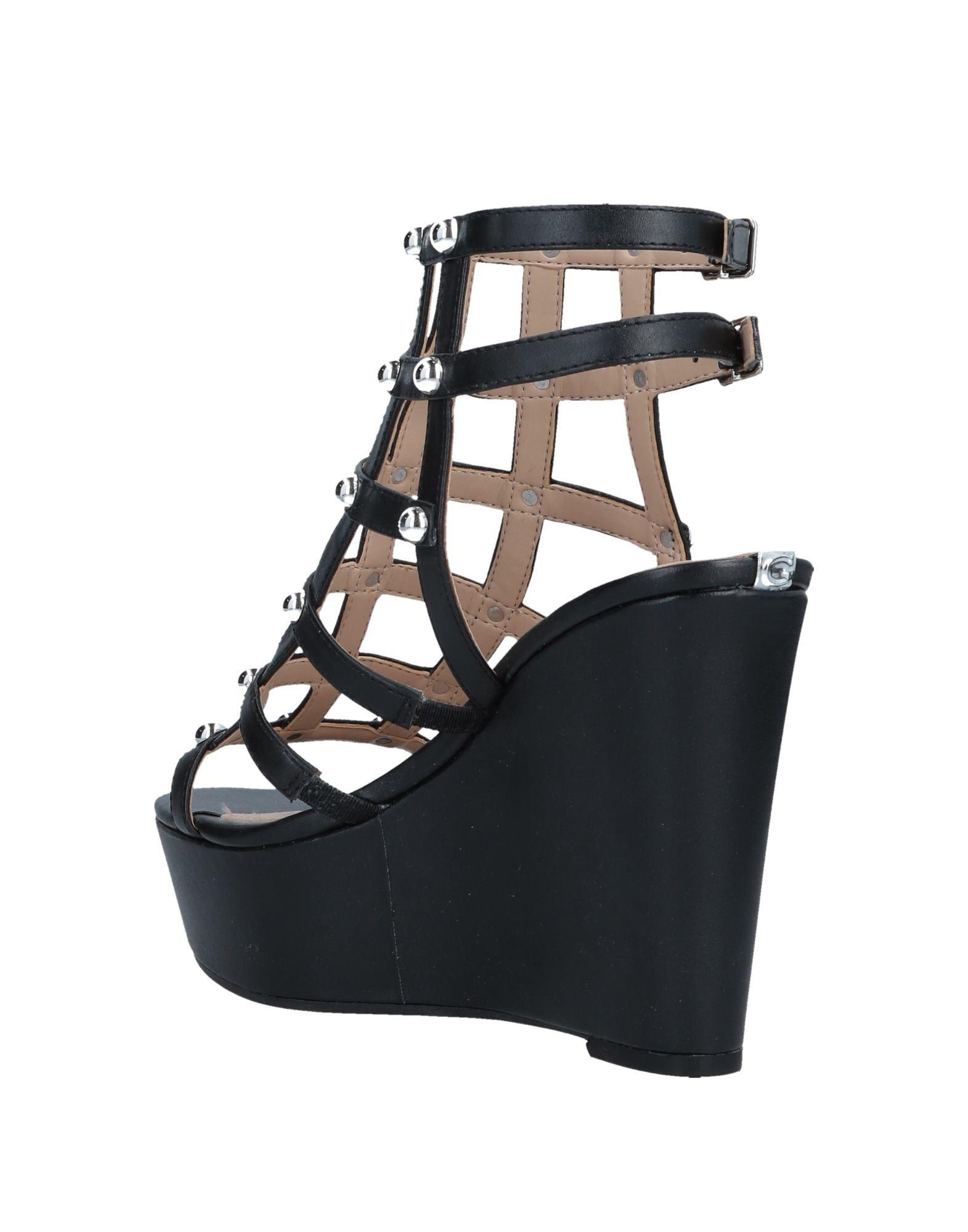 8ea59bbcc26862 Lyst - Guess Sandals in Black