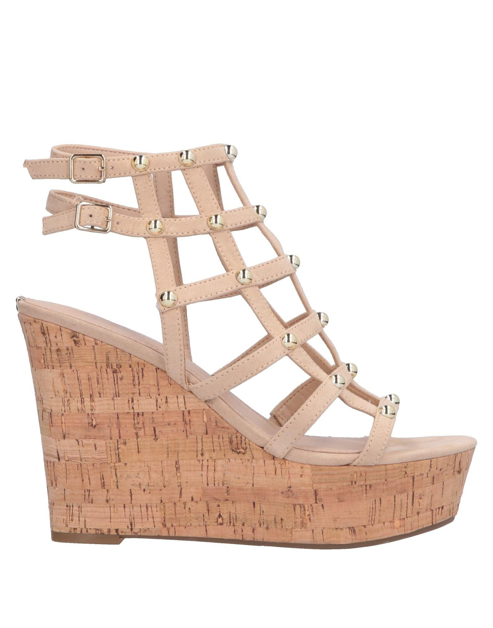 e627c6d8648177 Lyst - Guess Sandals in Natural