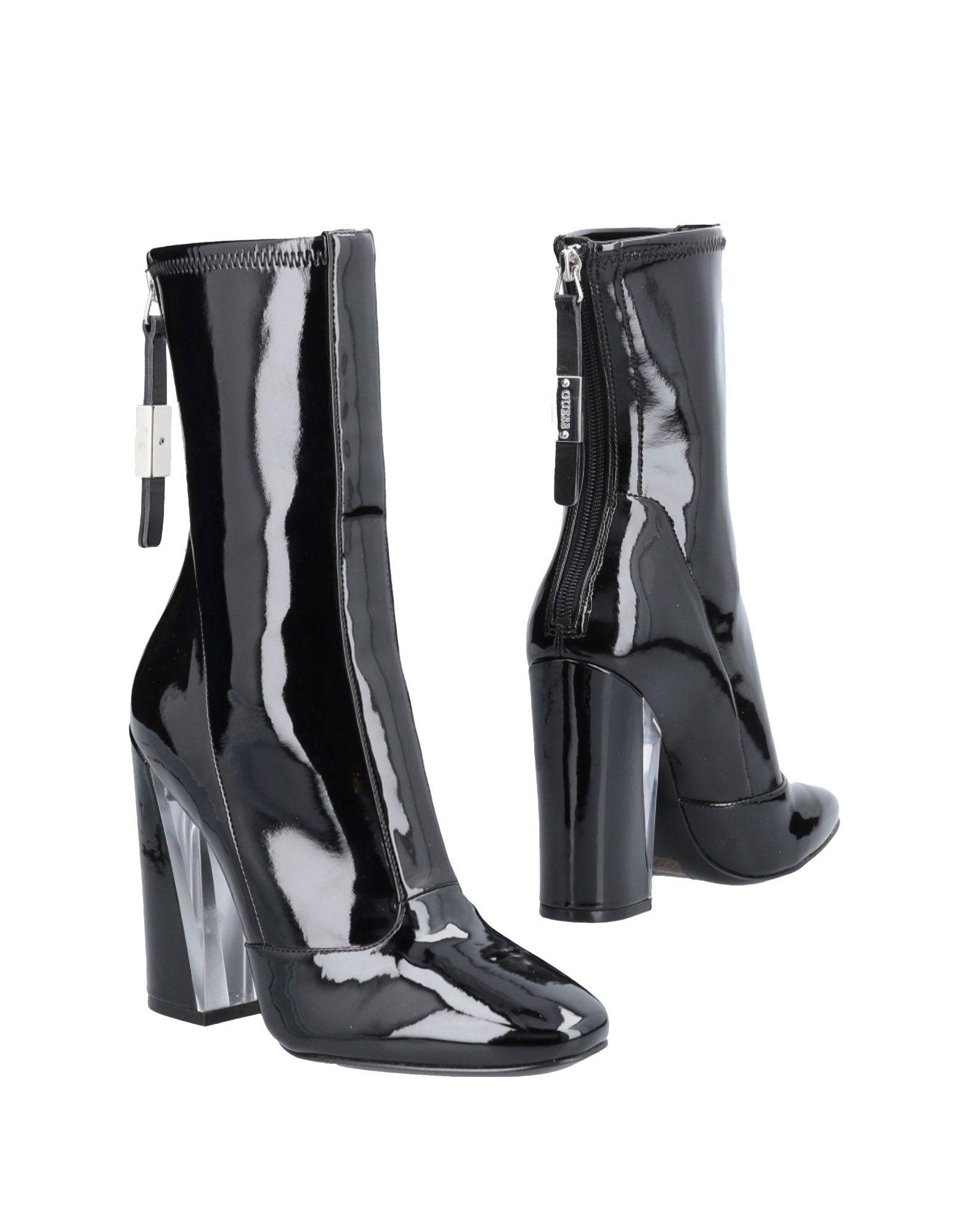02327f3e108f Guess - Black Ankle Boots - Lyst. View fullscreen