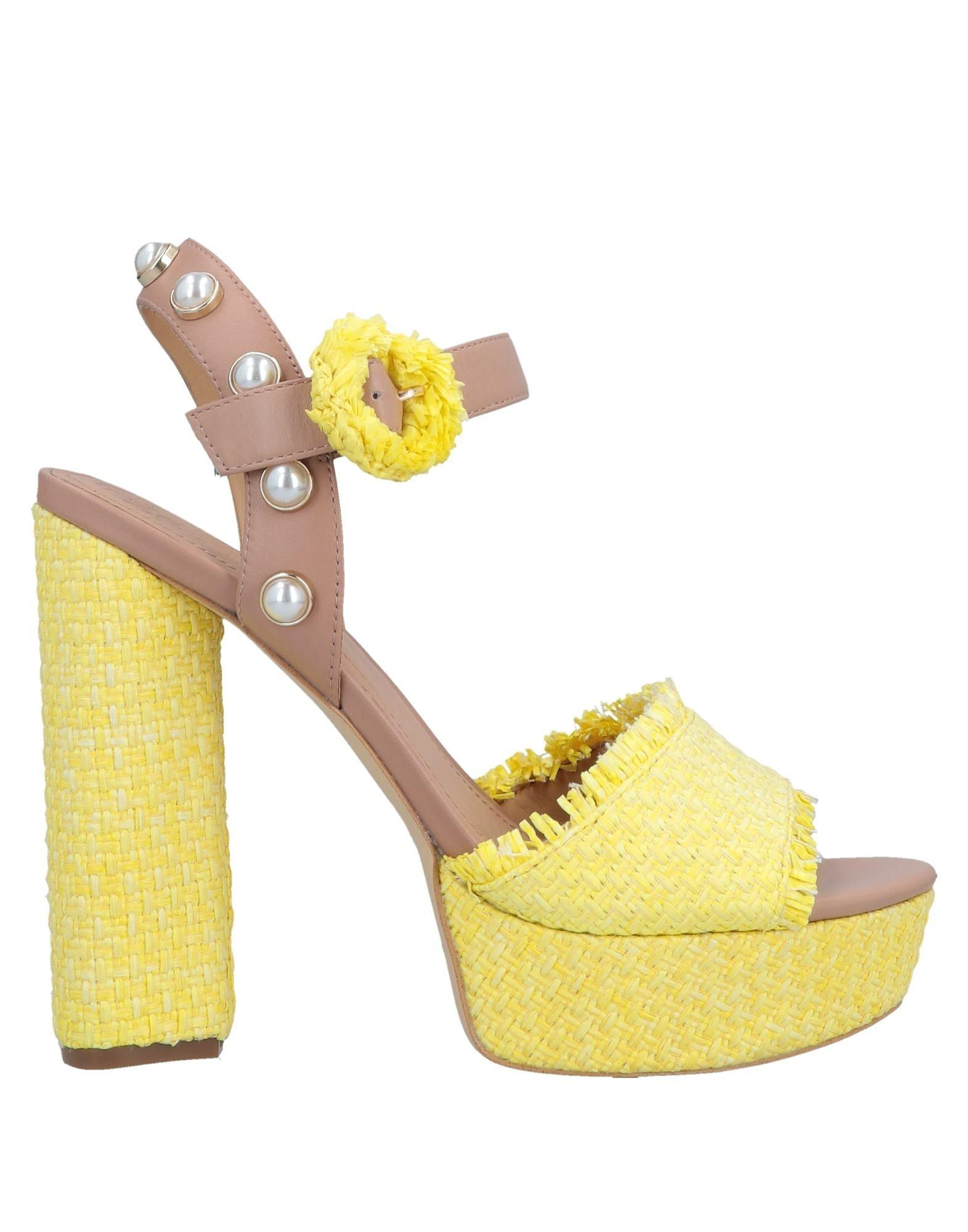 70ba472455e5 Lyst - Guess Sandals in Yellow
