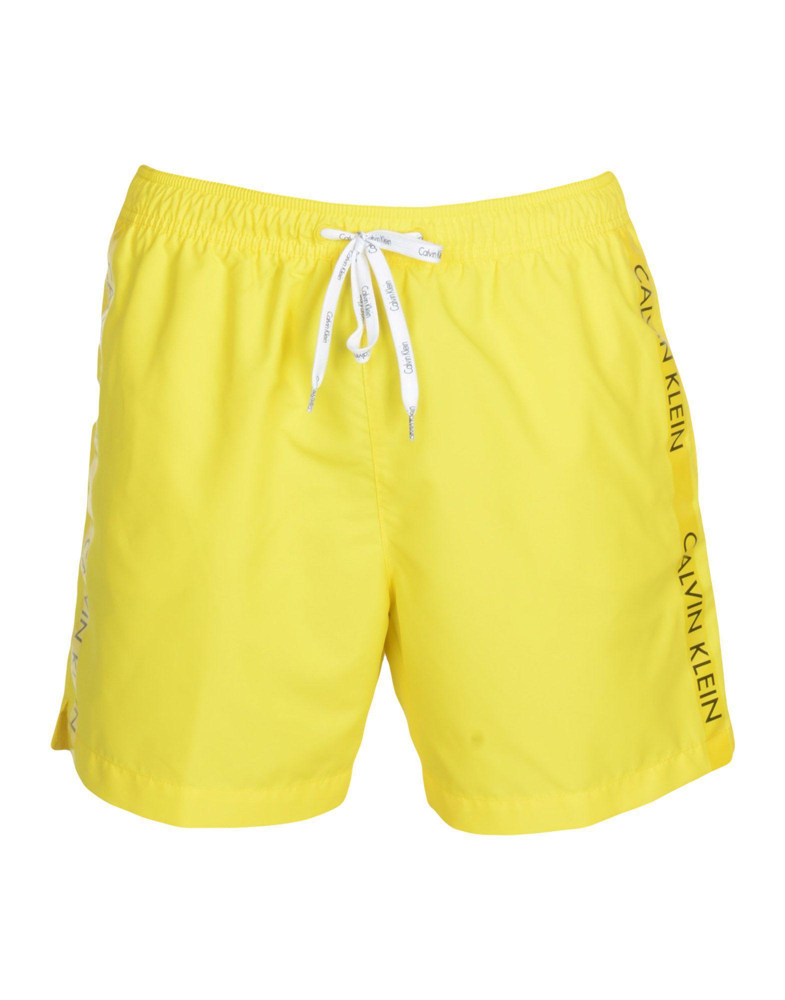 9dbedf3e1bf94 Calvin Klein Swimming Trunks in Yellow for Men - Lyst