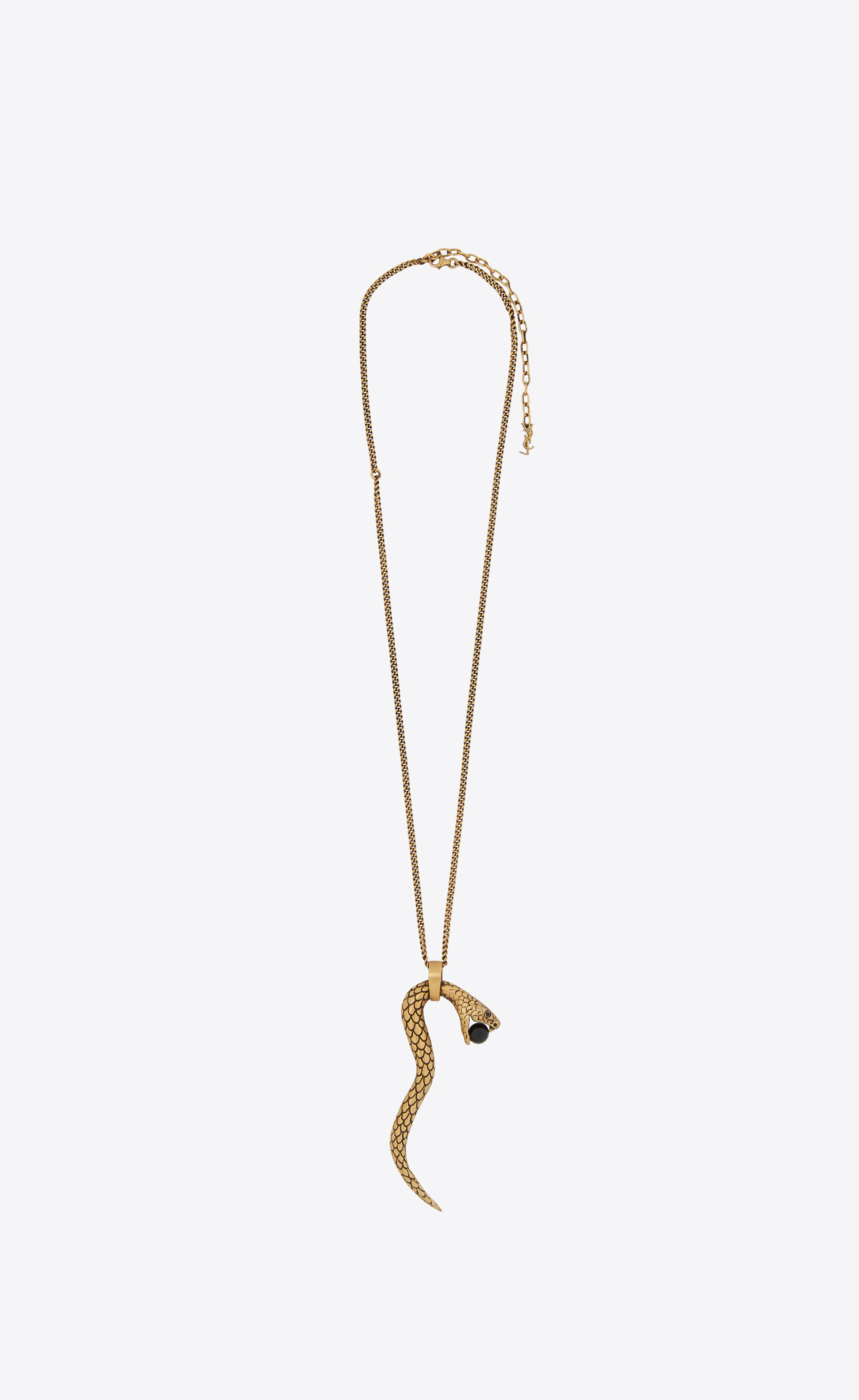 55696f83c0 Saint Laurent Snake Pendant In Gold Metal With A Black Glass Bead ...