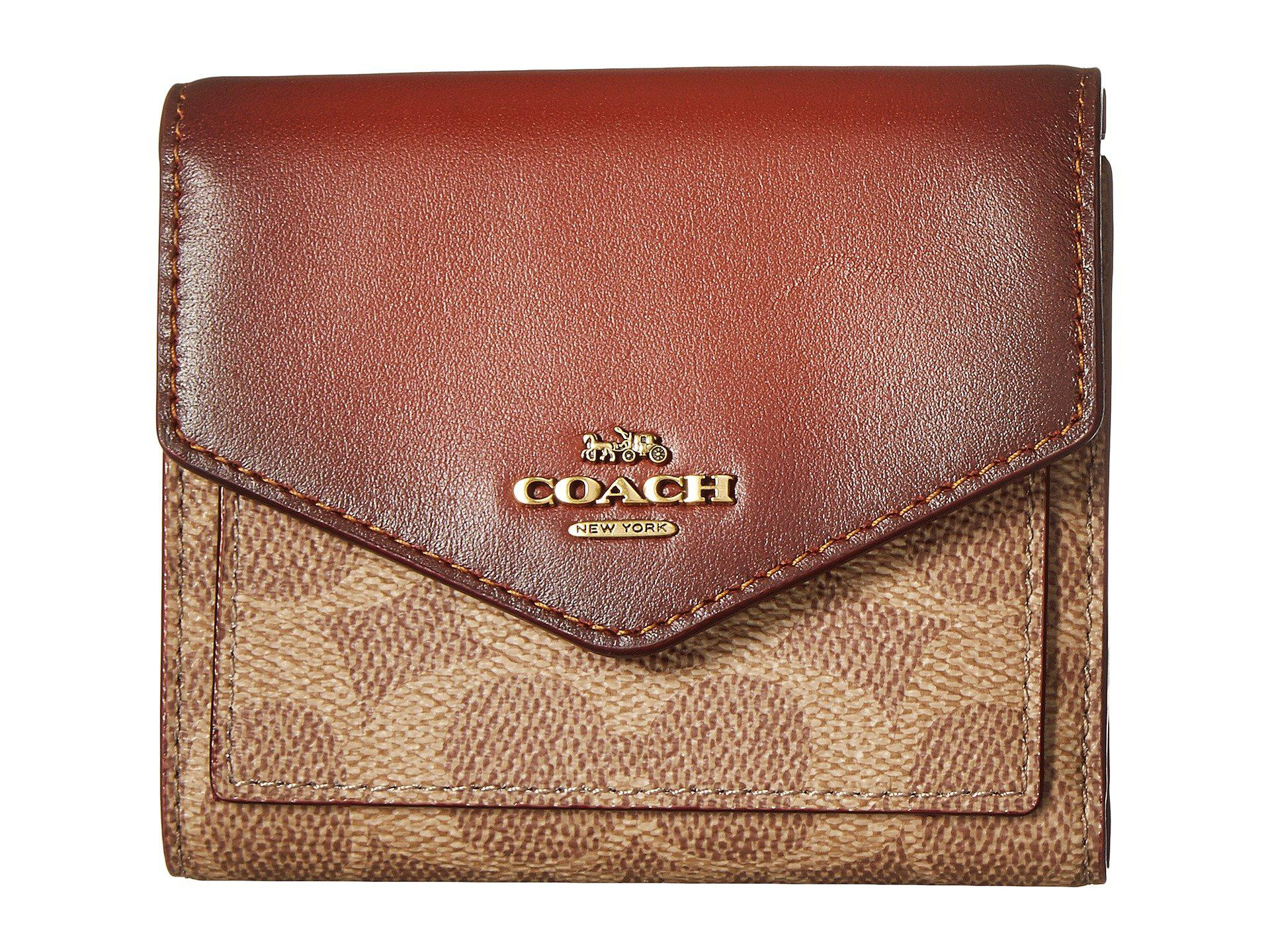 00e08a8ef4cc ... discount code for lyst coach small wallet in color block coated canvas  signature b4 3d23a 5c689 ...