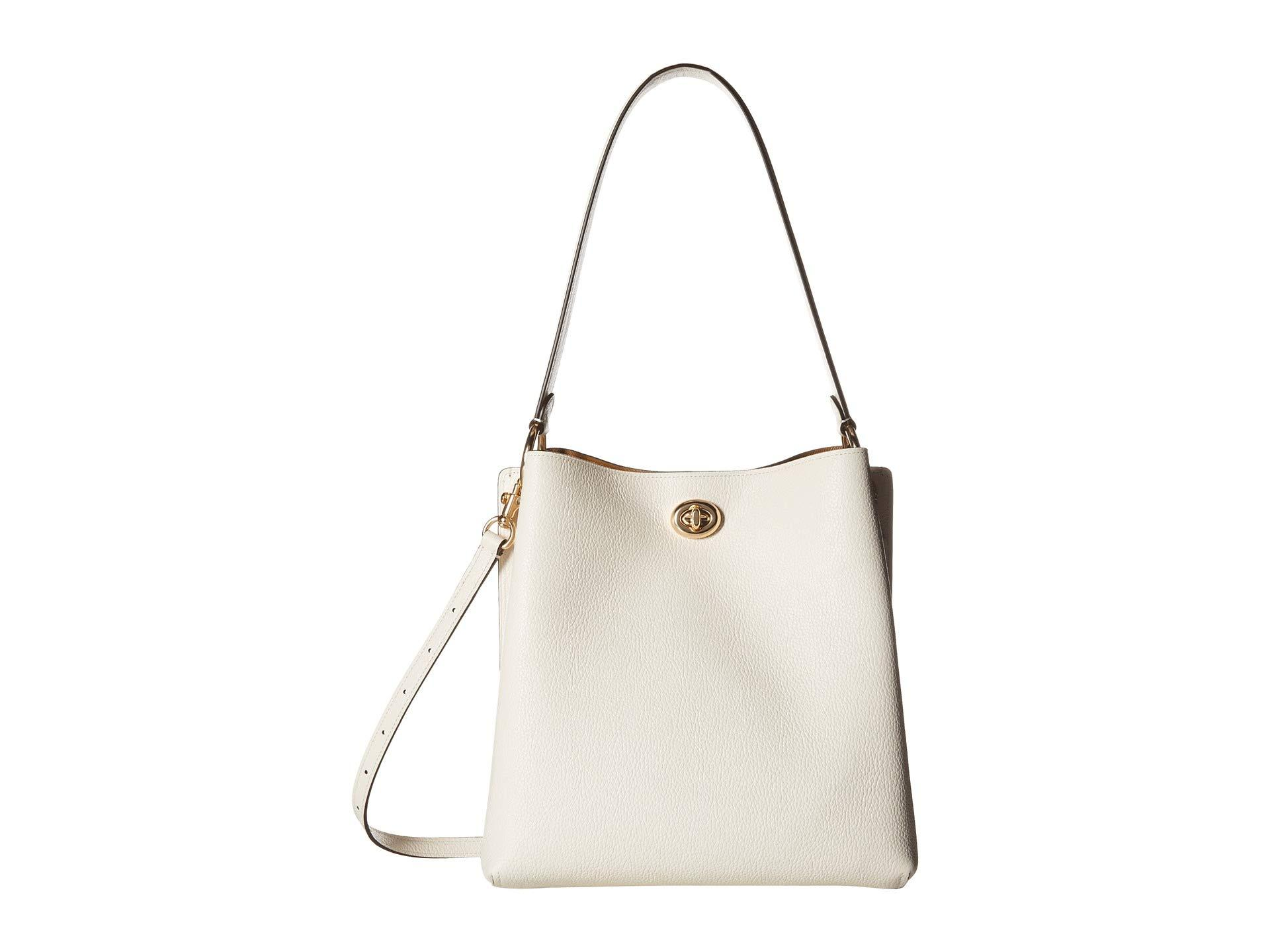82d4deb32 COACH. Women's Metallic Polished Pebble Leather Charlie Bucket  (blossom/silver) Handbags