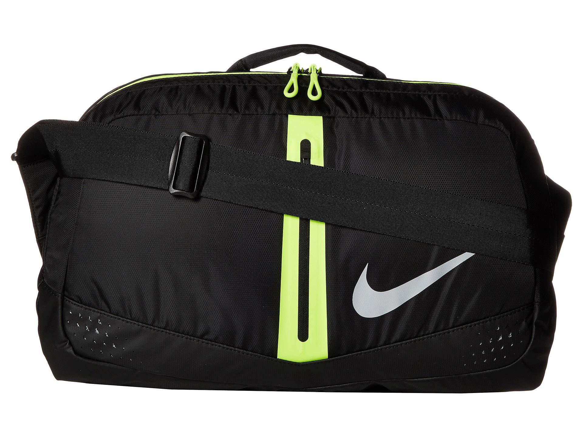 46723ae42a Lyst - Nike Run Duffel Bag 34l (black volt silver) Duffel Bags in ...
