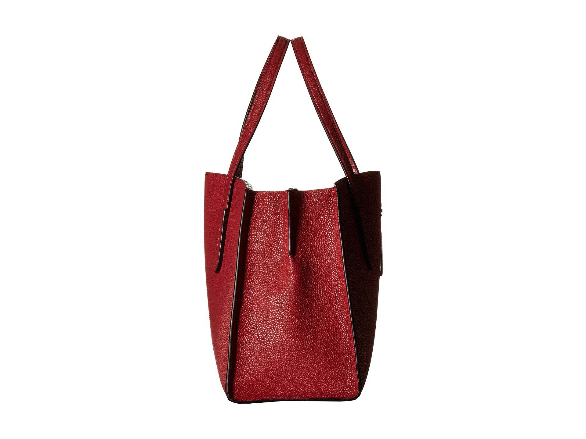 bf411a1428b5 Lyst - COACH Polished Pebble Leather Charlie Carryall in Red
