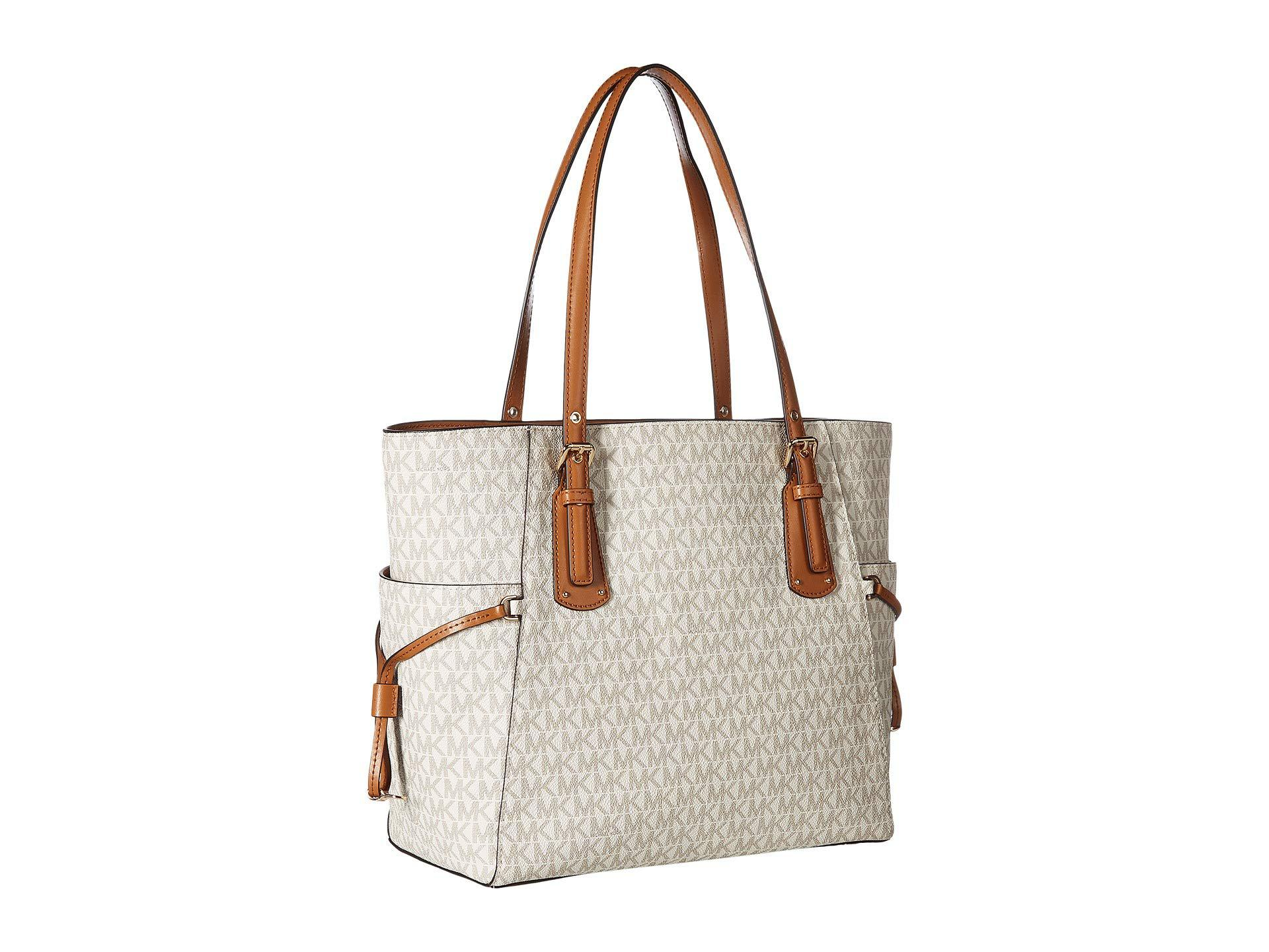 7f5293d034fd9f MICHAEL Michael Kors - Multicolor Voyager East/west Signature Tote (vanilla)  Tote Handbags. View fullscreen
