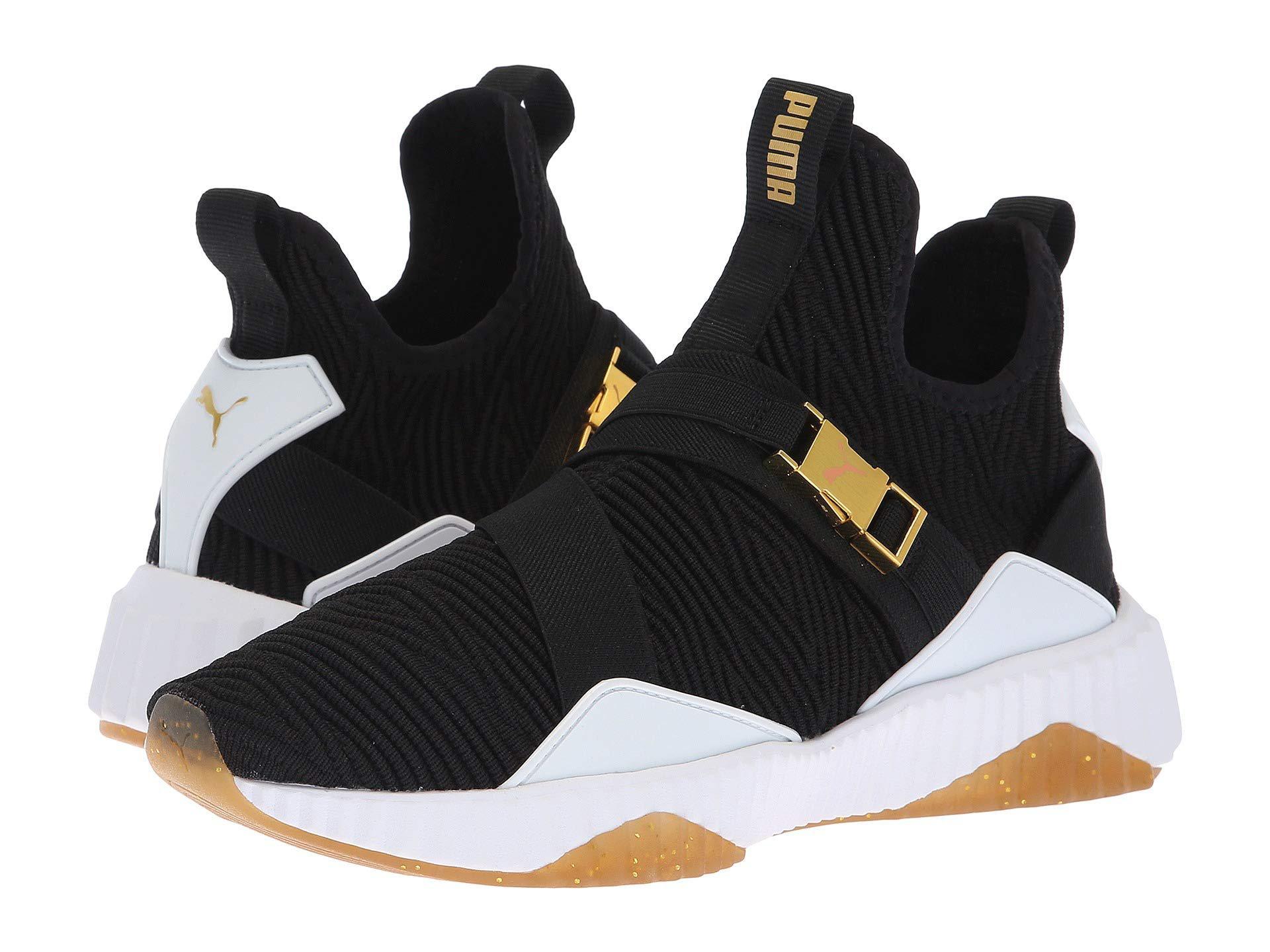 903f28393ca2 Lyst - PUMA Defy Mid Varsity ( Black metallic Gold) Women s Shoes in ...
